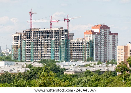 Tower cranes on construction site of modern buildings and skyscrapers. Moscow, Russia.  - stock photo