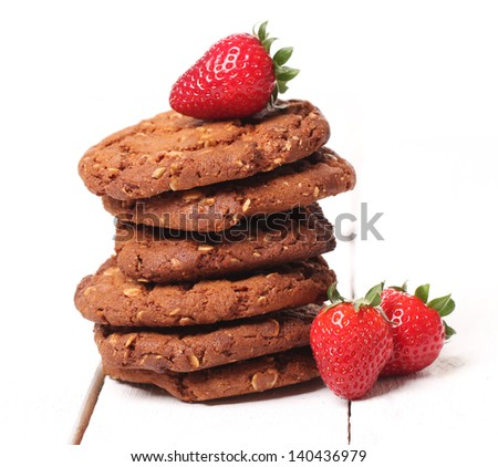 Tower from homemade tasty oatmeal cookies and strawberries
