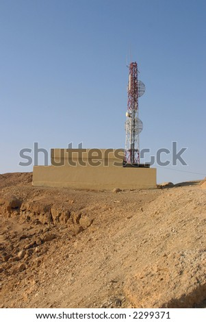 Tower GSM of communication in desert in mountains - stock photo