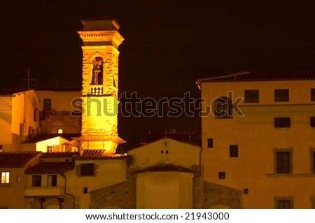 Tower illuminated at night in Florence Italy.
