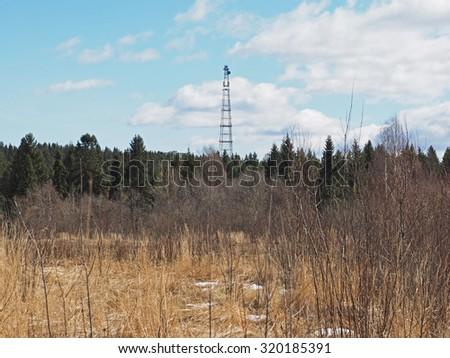 tower in a field - stock photo