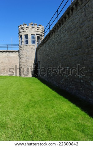 tower in an old prison showing wall - stock photo