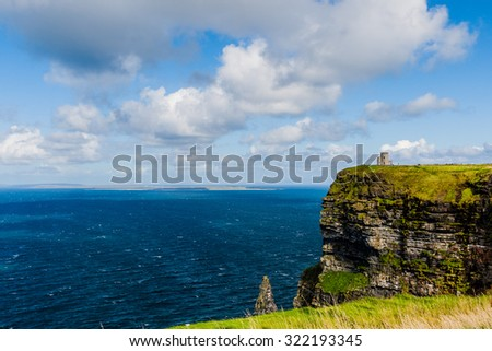 Tower marks the highest point of the Cliffs of Moher in County Clare, Ireland, located from the village Doolin - stock photo