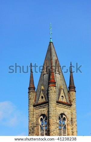 Tower of a historic church under the blue sky, victoria downtown, british columbia, canada