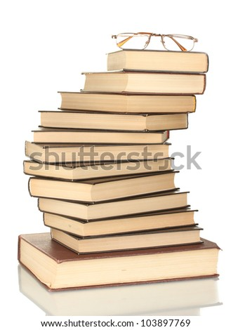 tower of books with glasses isolated on white background