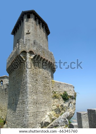 Tower of castle on the top of rock in San-Marino - stock photo