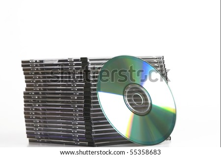tower of cd dvd case  on white background - stock photo