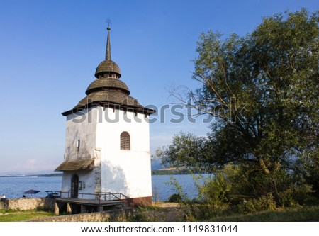 Tower of Church of the Virgin Mary at shore of Liptovska Mara Water Reserve, Liptov, Slovakia