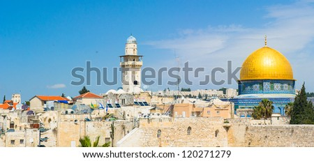 Tower of David and The dome of the Rock shrine, located in the center of the temple moun of Jerusalem, Israelt, is one of the most beautiful and enduring shrines in the World. - stock photo