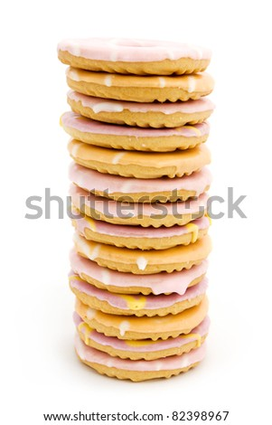 Tower of iced biscuits isolated on white