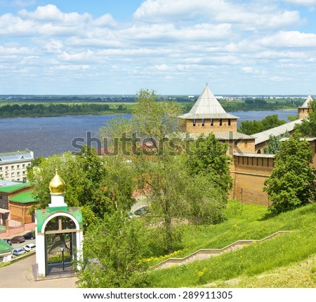 Tower of Kremlin fortress and view on river Volga in town Nizhny Novgorod, Russia. - stock photo