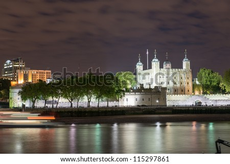 Tower of London and Thames river at Night - London - UK - stock photo