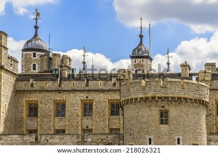Tower of London - historic castle on the north bank of the River Thames in central London - a popular tourist attraction. View of Tower from outside walls. - stock photo
