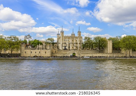Tower of London - historic castle on the north bank of the River Thames in central London - a popular tourist attraction. View of Tower from River Thames. - stock photo