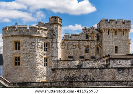 Tower of London - historic castle on the north bank of the River Thames in central London, a popular tourist attraction. View from outside walls. - stock photo