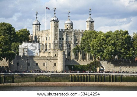tower of london on the thames river in england