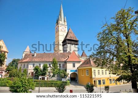 Tower of lutheran church from XVth century in Medias, Transylvania, Romania - stock photo