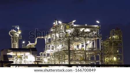Tower of oil refinery at twilight time