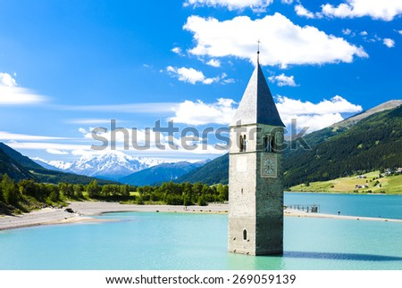 tower of sunken church in Resia lake, South Tyrol, Italy - stock photo