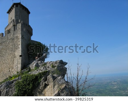 Tower of the castle on the hill in San Marino - stock photo