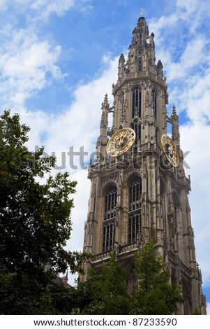 Tower of the Cathedral Our Lady's in Antwerp, Belgium strives for a blue sky. - stock photo