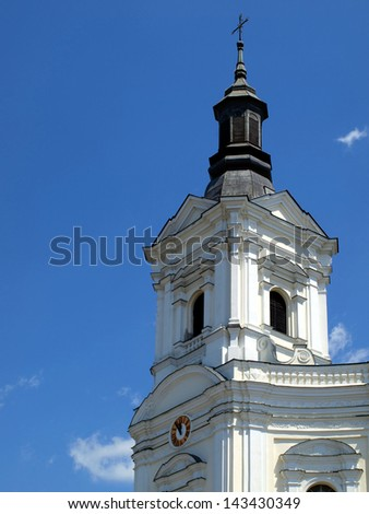 Tower of the church, the Basilica of the Shrine of the Virgin Mary in Kodeniu on the Bug River in Poland - stock photo
