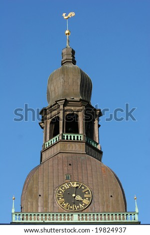 Tower of the famous Dome Cathedral (Old town, Riga, Latvia) - stock photo