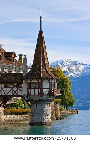 Tower of the Oberhofen castle on the lake of Thun (Switzerland) - stock photo