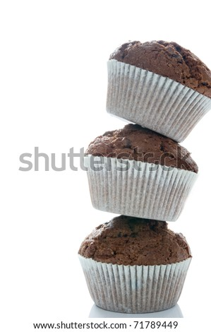 Tower of three chocolate muffins on a white background - stock photo