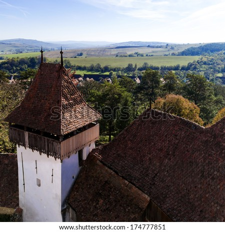 Tower of Viscri fortified church in Romania - stock photo