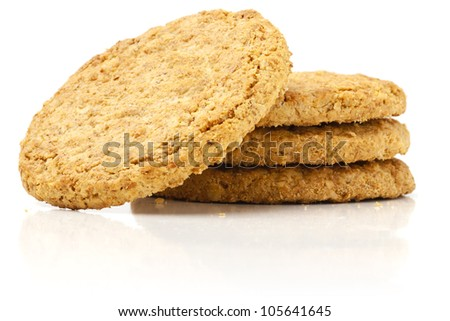 Tower of  wheat Biscuits from low viewpoint on white background. - stock photo