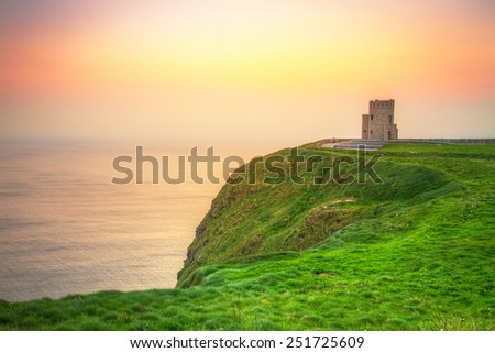 Tower on the Cliffs of Moher at sunset, Ireland - stock photo