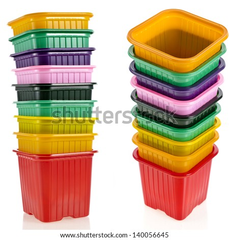 tower stack of colorful  plastic pot for seedling  isolated on white background - stock photo