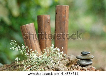 Tower stone with beautiful background. Selective focus on the tower stone. Concept of tranquility,peace and relaxing. Concept of design for small garden. - stock photo