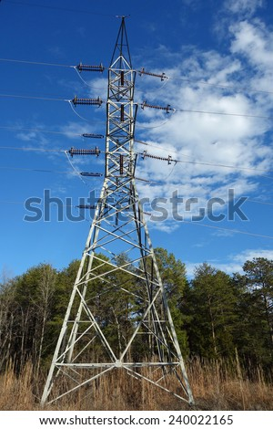Tower supporting high voltage electric lines in rural America - stock photo