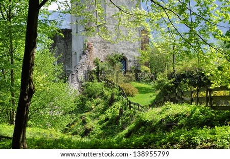 tower with blue door of a castle in the alps 4 - stock photo