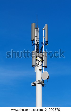 Tower with cellular antennas - stock photo