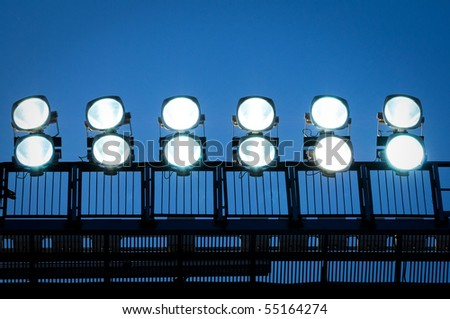 tower with lighting floodlights at the stadium - stock photo