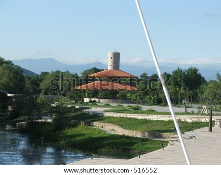 Tower with roof and surrounding park, hotel Plavnica on Skadarsko Lake, Montenegro