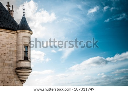 Tower with window of the ancient castle, dark blue sky with clouds in background. Chateau de Chaumont, Loire Valley Castles, France, Europe. - stock photo