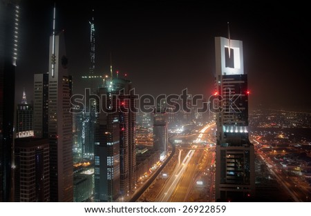 Towering city skyscraper blocks in Dubai with view of Burj