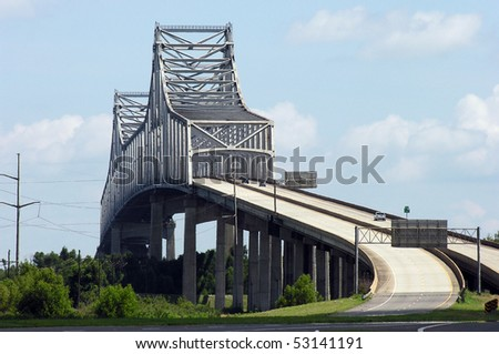Towering Gramercy Bridge over the Mississippi river in rural Louisiana. - stock photo