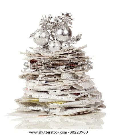 Towering stack of receipts make a holiday tree - stock photo