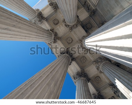 Towering supreme court columns in Washington DC. - stock photo