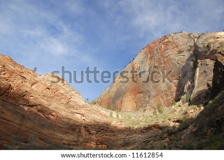 Towering walls of Zion Canyon in evening light - stock photo