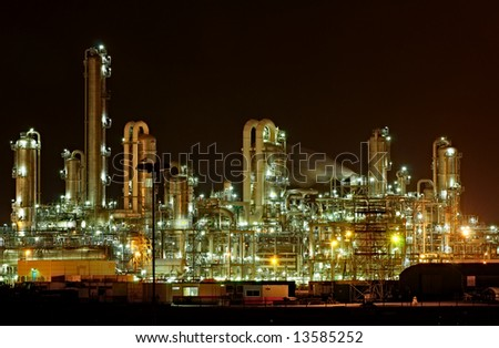 Towers and pipes of a chemical production facility at night