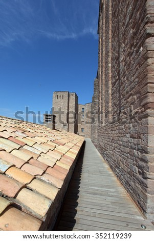 Towers and roof inside Cardona medieval castle in Spain - stock photo