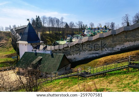 Towers and walls of the fortress of monastery in Pechory, Russia - stock photo
