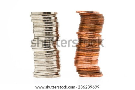 Towers made out of silver and brass coins over white background