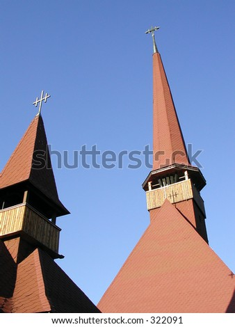 Towers of a rustic monastery - stock photo
